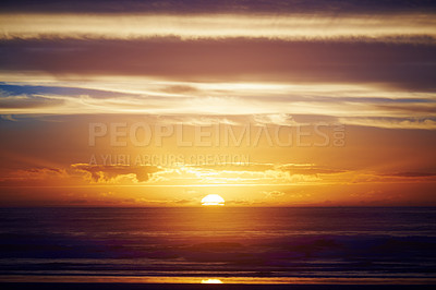 Buy stock photo Shot of a scenic sunset over the sea and mountain