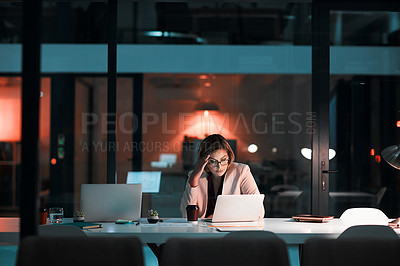 Buy stock photo Shot of a businesswoman feeling worn out during a late night at work