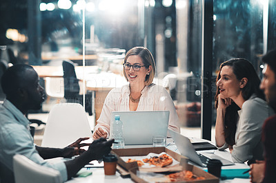 Buy stock photo Shot of colleagues collaborating on a project in a modern office