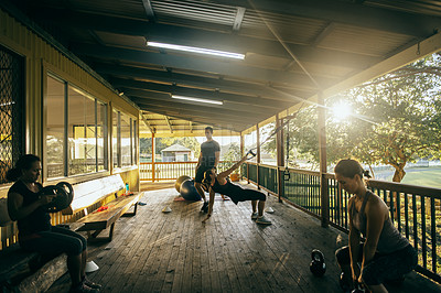 Buy stock photo Shot of a group of women working out together at a training facility