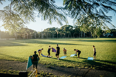 Buy stock photo Shot of a group of women getting ready to workout together on a field