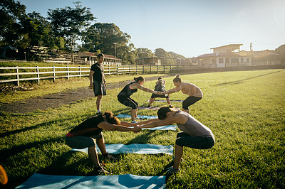 Buy stock photo Shot of a group of women working out together on a field