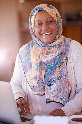 Buy stock photo Cropped shot of a mature muslim woman using her laptop at home