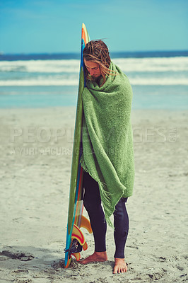 Buy stock photo Cropped shot of a young surfer leaning against his surfboard