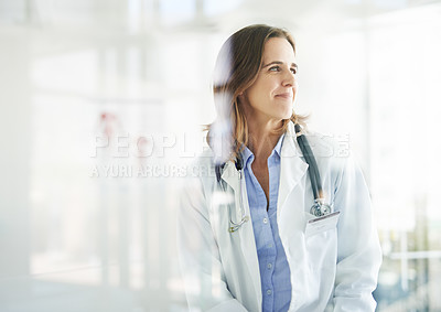 Buy stock photo Shot of a mature doctor looking thoughtful in a consulting room
