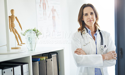 Buy stock photo Portrait of a confident mature doctor working in a consulting room