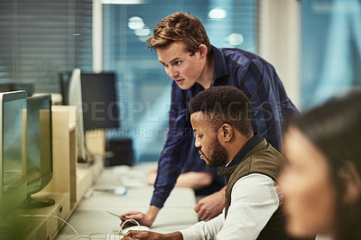 Buy stock photo Shot of a group of designers working on computers in an office