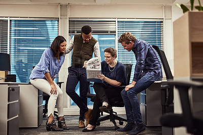 Buy stock photo Shot of a group of designers brainstorming together in an office