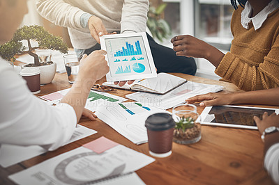 Buy stock photo Shot of a group of businesspeople discussing statistics