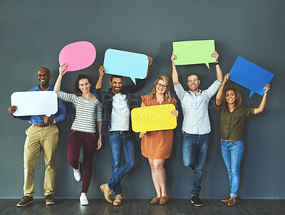 Buy stock photo Studio shot of a diverse group of people holding up speech bubbles against a gray background