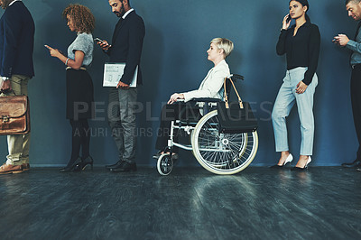 Buy stock photo Shot of a woman in a wheelchair waiting in line to be interviewed
