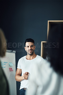 Buy stock photo Shot of a group of colleagues having a brainstorming session in a modern office