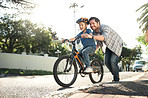 Who better to learn how to ride than with dad