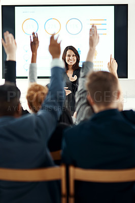 Buy stock photo Shot of a young businesswoman answering questions during a presentation in the office