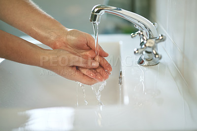 Buy stock photo Cropped shot of hands being washed at a tap