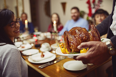 Buy stock photo Closeup shot of a turkey being served during a feast at a dining table