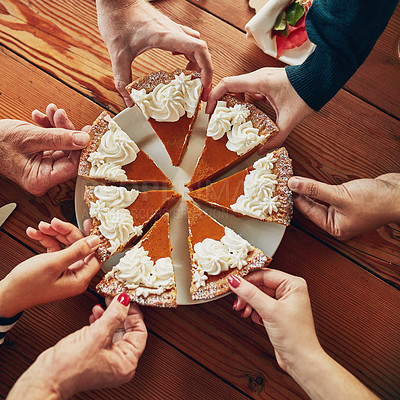 Buy stock photo Cropped shot of a group of people each taking a slice of pumpkin pie