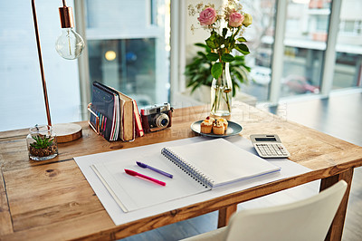 Buy stock photo Shot of a creative workstation in a modern office