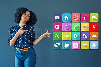 Buy stock photo Studio shot of a young woman pointing towards various notification icons against a gray background
