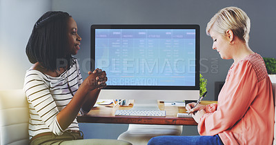 Buy stock photo Shot of two businesswomen brainstorming together in an office