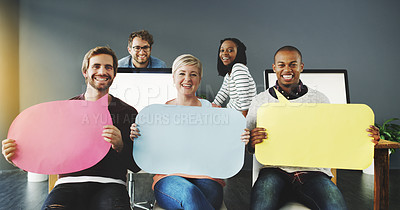 Buy stock photo Shot of a diverse group of people holding up speech bubbles in a modern office