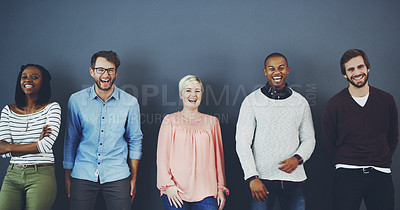 Buy stock photo Studio shot of a diverse group of people standing together against a gray background