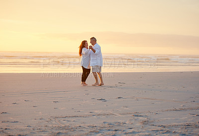 Buy stock photo Shot of a mature couple dancing on the beach