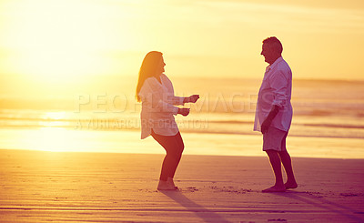 Buy stock photo Full length shot of an affectionate mature couple dancing on the beach at sunset