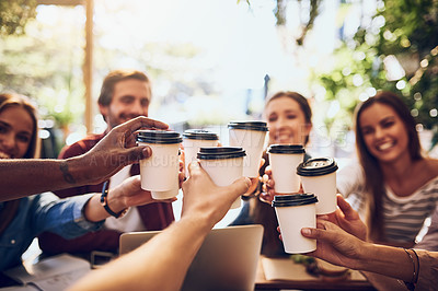 Buy stock photo Cropped shot of a group of friends toasting with cups of coffee while out together
