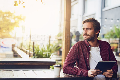 Buy stock photo Cropped shot of a handsome young using his digital tablet outside