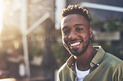 Buy stock photo Cropped shot of a handsome young man chilling at an outdoors coffee shop