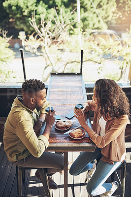 Buy stock photo Cropped shot of a young couple in a coffee shop
