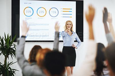 Buy stock photo Shot of a group of unrecognizable businesspeople raising their hands to ask questions during a presentation