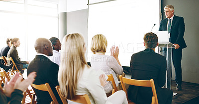 Buy stock photo Cropped shot of a handsome mature businessman giving a speech during an award ceremony