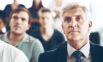 Buy stock photo Cropped shot of a group of corporate businesspeople sitting in an auditorium during an award ceremony
