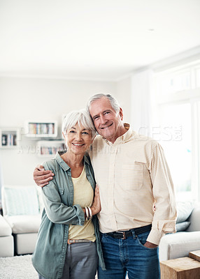 Buy stock photo Portrait of a happy elderly couple standing together in their home