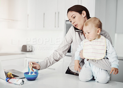 Buy stock photo Cropped shot of an overwhelmed mother trying to multitask while holding her baby boy