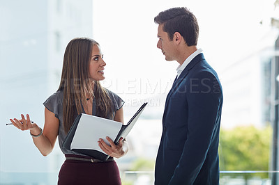 Buy stock photo Cropped shot of two businesspeople having a discussion in the office