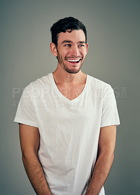 Buy stock photo Studio shot of a casual young man posing against a grey background