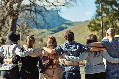 Buy stock photo Rearview shot of a group of friends standing together