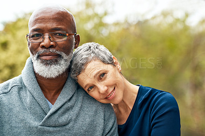 Buy stock photo Shot of a happy senior couple enjoying quality time at the park