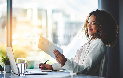 Buy stock photo Shot of a young beautiful businesswoman working in the office