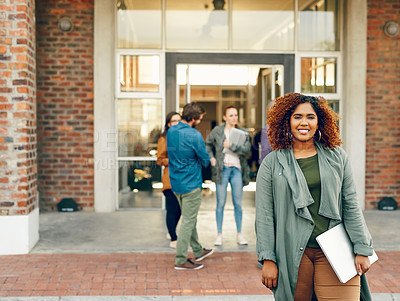 Buy stock photo Portrait of a happy young woman holding a laptop outdoors on campus