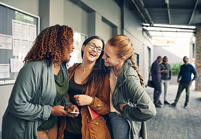 Buy stock photo Shot of a group of happy young students laughing together outdoors on campus