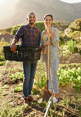 Buy stock photo Portrait of two young farmers working in a garden