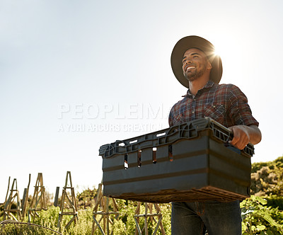 Buy stock photo Shot of a young man working in a garden