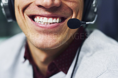 Buy stock photo Closeup shot of an unidentifiable call centre agent working late in an office
