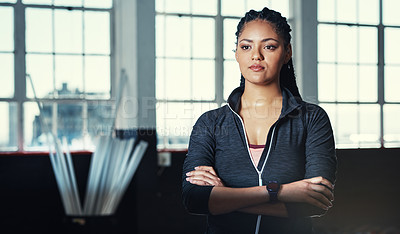 Buy stock photo Portrait of a young woman in a gym