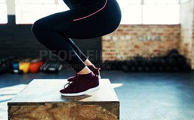 Buy stock photo Shot of an unrecognizable woman doing a exercise jump on a wooden block in a gym