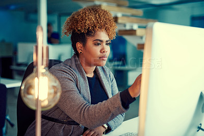 Buy stock photo Shot of a young businesswoman working late in an office